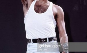 LONDON - JULY 13: Freddie Mercury of Queen performs on stage at Live Aid at Wembley Stadium on 13th July 1985 in London. (Photo by Phil Dent/Redferns)