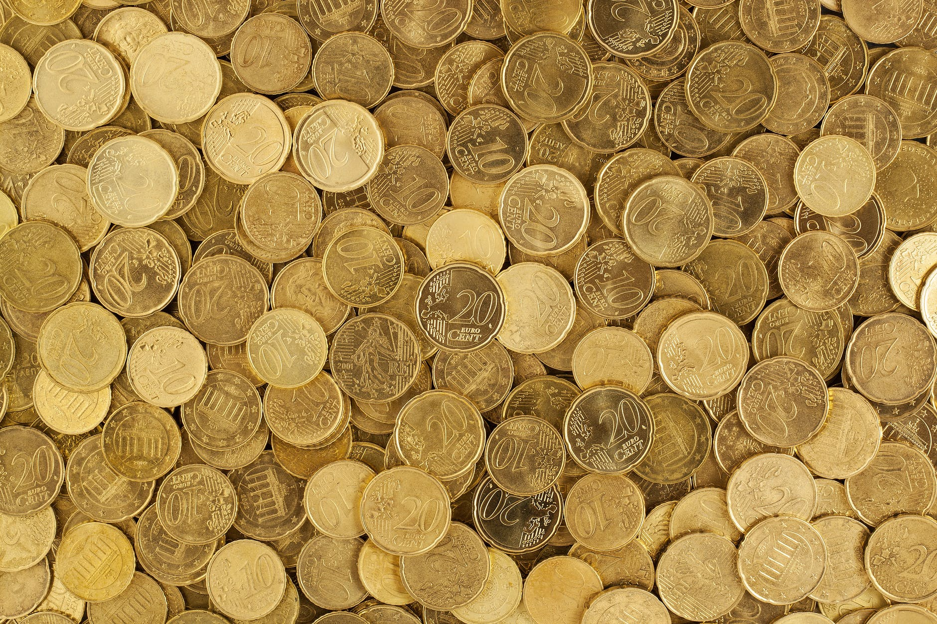 pile of gold round coins